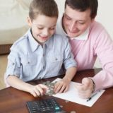 kid and father with a calculator