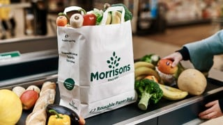 Pictures to show how Morrisons is giving customers the option of using large paper carrier bags in eight of its stores from this week. The trial is a response to customers who have told Morrisons reducing plastic is their number one environmental concern. The new US-style paper grocery bags have handles and are a similar capacity to standard plastic carrier bags.  They are 100% PEFC accredited meaning they are sourced from forests that are managed responsibly.  