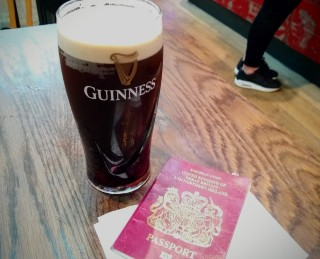 Pint of Guinness and UK passport.