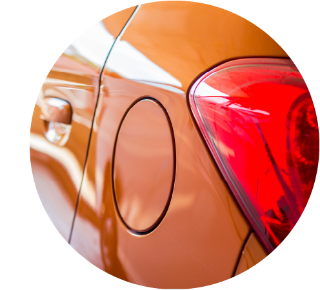 Close up of the fuel cap on an orange car.