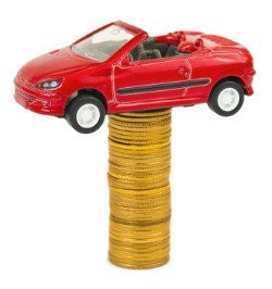 model of a car on top of a pile of coins