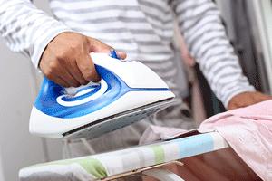 Lady ironing on iron board