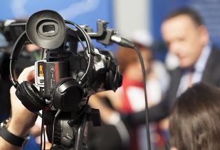 Camera filming TV set